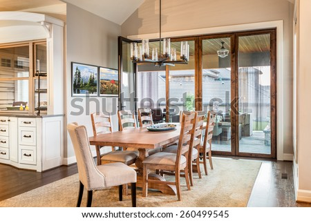 Dining Room with Entryway, Table, Elegant Light Fixture - stock photo