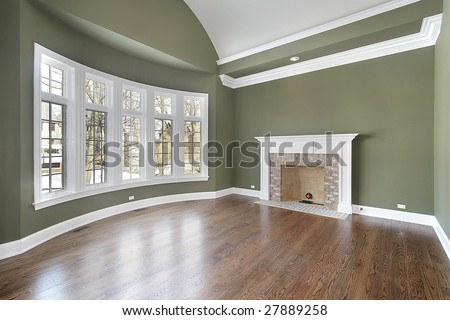 Dining Room With Fireplace And Green Walls