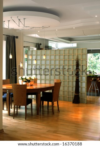 dining room with glass wall - stock photo