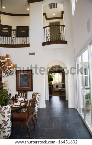 Dining room with luxury home hallway. - stock photo