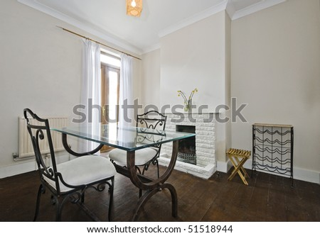 dining room with vintage furniture and fireplace