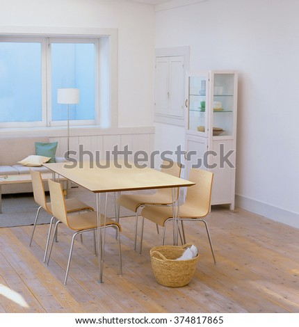 dining room with wood table - stock photo