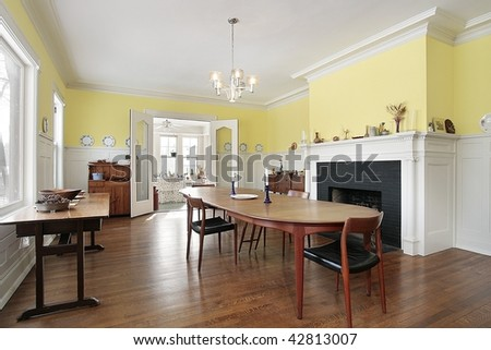 Dining room with yellow walls