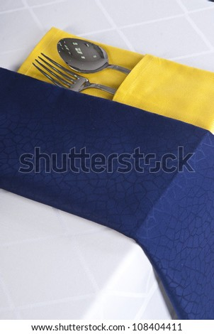 Dining set on white table linen background. - stock photo