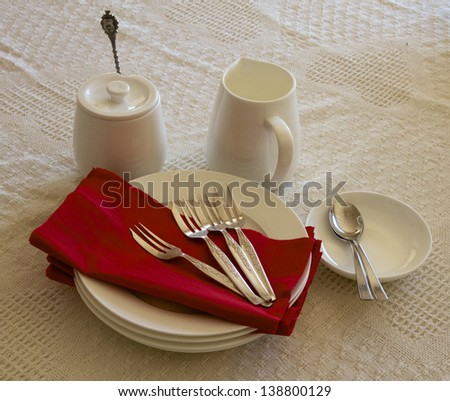 Dining Setting in White with Red Napkin.  - stock photo