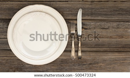 Dining setting or table setting of silverware or cutlery including a fork and a knife on & Dining Setting Table Setting Silverware Cutlery Stock Photo (Royalty ...