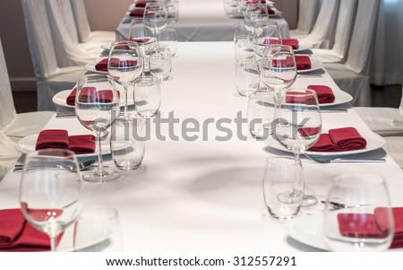 Dining table arrangement inside a restaurant. - stock photo