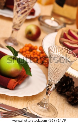 Dining table decorated and set for thanksgiving meal - stock photo