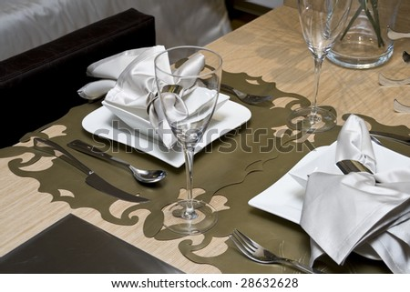 Dining table in a dining room - stock photo