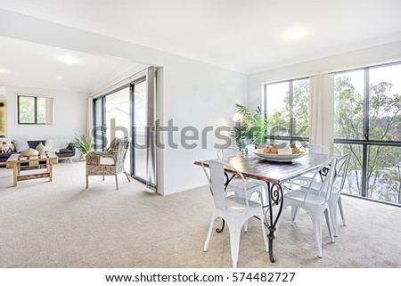 Dining Table In A Luxury House Interior, Comfortable Furniture With  Designs, Walls Are White