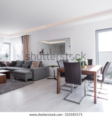 Dining table in bright exclusive living room - stock photo