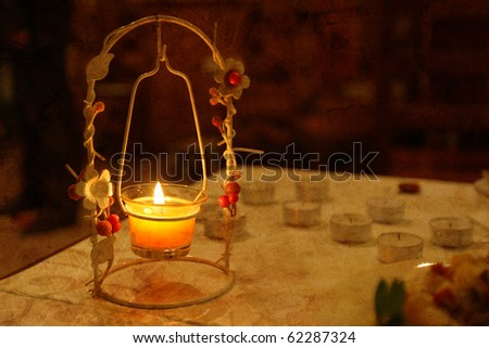 Dining table in soft candle light - stock photo