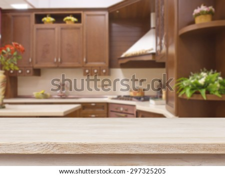 Dining table on blurred brown kitchen interior background - stock photo