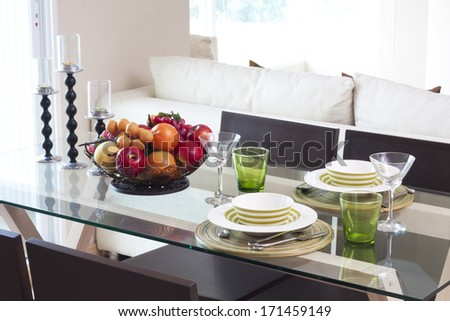 dining table ready for couple in apartment. - stock photo