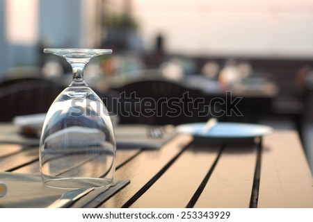 Dining table set with glass - stock photo