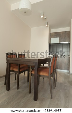 dining table with chairs in apartment