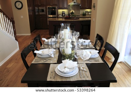Dining table with contemporary tableware and festive decor. - stock photo