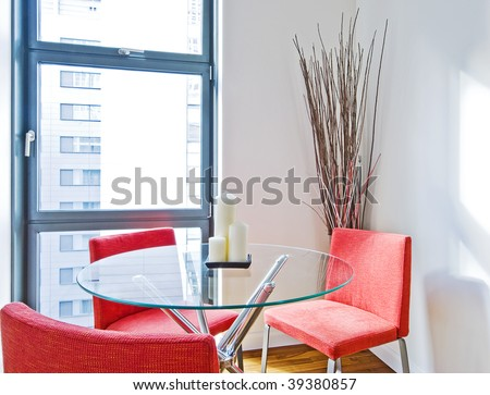 dining table with glass top and three red chairs - stock photo