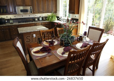 Dining table with luxury home kitchen.