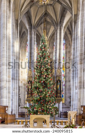 DINKELSBUEHL, GERMANY - DEC 23, 2014: inside St. George's Minster in Dinkelsbuehl, Germany. It is a  masterpiece in the Gothic style of the late 15th century  by Nikolaus Eseler.