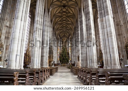 DINKELSBUHL ,GERMANY - DECEMBER 22, 2012: The interior of the Church of St. George in Dinkelsbuhl, Bavaria. It is a masterpiece in the Gothic style of the late 15th century by Nikolaus Eseler. - stock photo