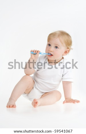 Dinky little girl clears teeth on white background. - stock photo