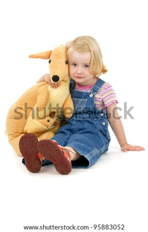 Dinky little girl his toy on white background - stock photo