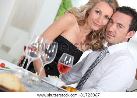 Dinner guests at the table - stock photo