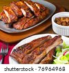 Dinner of ribs, beans and salad - stock photo