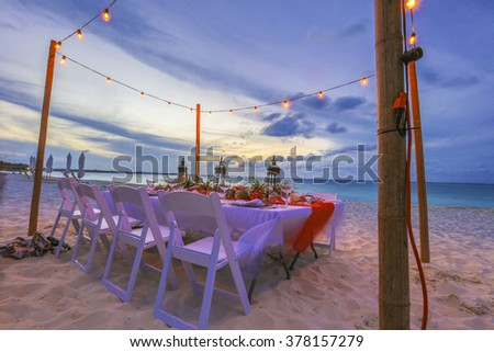 Dinner on the beach in the Caribbean - stock photo
