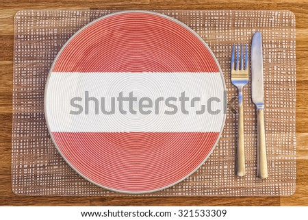 Dinner plate with the flag of Austria on it for your international food and drink concepts. - stock photo