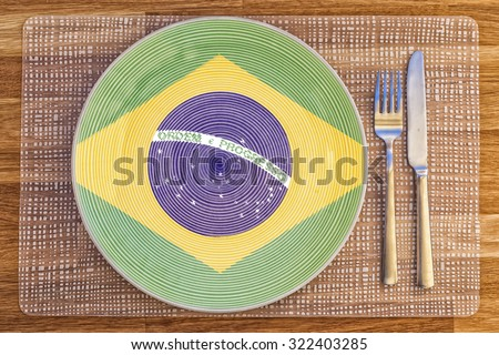 Dinner plate with the flag of Brazil on it for your international food and drink concepts. - stock photo