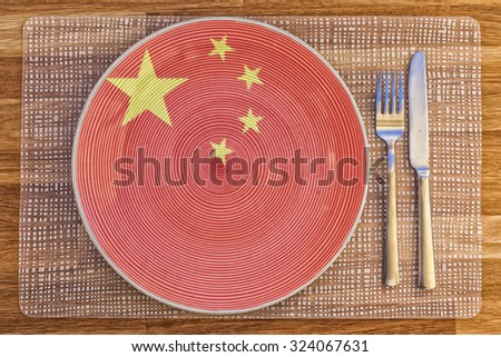 Dinner plate with the flag of China on it for your international food and drink concepts. - stock photo