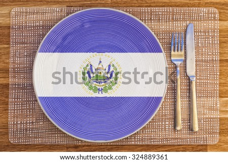Dinner plate with the flag of El Salvador on it for your international food and drink concepts. - stock photo