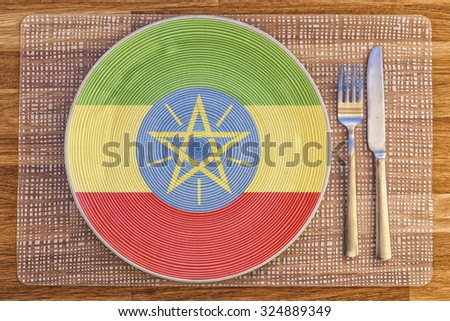 Dinner plate with the flag of Ethiopia on it for your international food and drink concepts. - stock photo