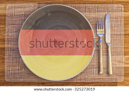 Dinner plate with the flag of Germany on it for your international food and drink concepts. - stock photo