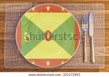 Dinner plate with the flag of Grenada on it for your international food and drink concepts. - stock photo