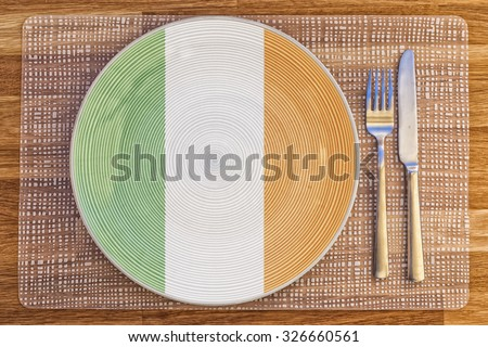 Dinner plate with the flag of Ireland on it for your international food and drink concepts. - stock photo