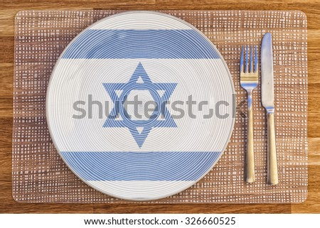 Dinner plate with the flag of Israel on it for your international food and drink concepts. - stock photo