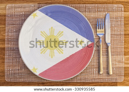 Dinner plate with the flag of Philippines on it for your international food and drink concepts. - stock photo