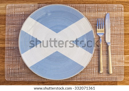 Dinner plate with the flag of Scotland on it for your international food and drink concepts. - stock photo
