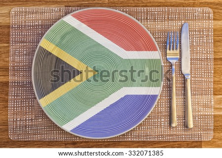Dinner plate with the flag of South Africa on it for your international food and drink concepts. - stock photo