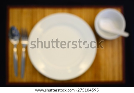 dinner set on the bamboo mat,blurred mode - stock photo