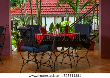 Dinner setting at evening - stock photo