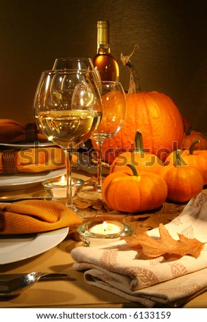 Dinner settings with wine for Thanksgiving - stock photo