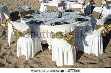 Dinner table at a beach wedding - stock photo