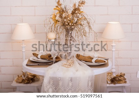 Dinner table served for two person decorated with winter decor. New Year interior. Christmas background.