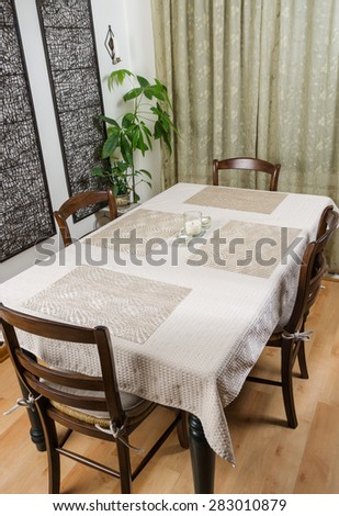 Dinner table with tablecloth - stock photo