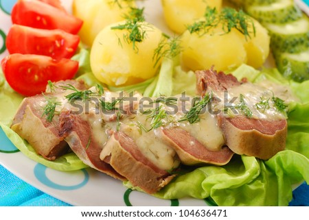 dinner with stewed pork tongue in horse radish and dill sauce, boiled potatoes,vegetables - stock photo