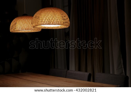 Dinning room design with table,chair and lamp at night - stock photo